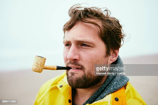 Man Smoking At Beach