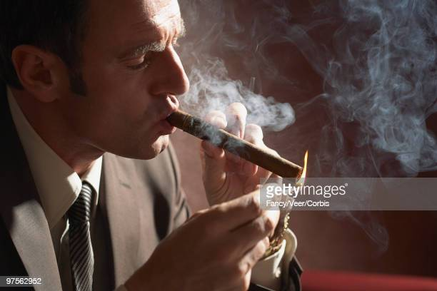 man smoking cigar - the fan of cigars stock pictures, royalty-free photos & images