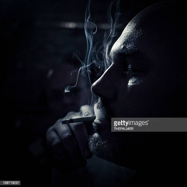 man smoking in the dark