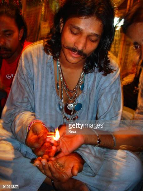 A man smoking Marijuana in a special terra cotta pipe locally called Chilim September 2006 in Sehwan Sharif Pakistan