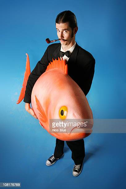 Man Smoking Pipe and Carrying Giant Fish