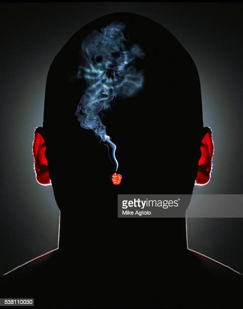 man smoking with skull and crossbones smoke - mike agliolo stock photos and pictures