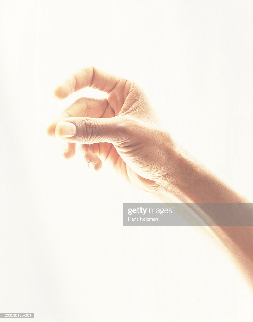 Man snapping fingers, close-up : Stock Photo