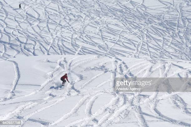 A man snow boards at Abali Ski Center on a Sunday morning in the Gevas district of Van Turkey on February 19 2017