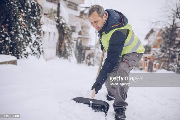 man snow cleaning alone - absence stock pictures, royalty-free photos & images