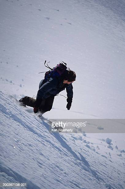 man snowboarding down slope, chugach mountain alaska, usa, elevated view - chugach state park stock pictures, royalty-free photos & images