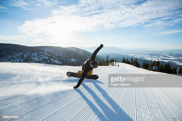 man snowboarding downhill - boarding stock pictures, royalty-free photos & images