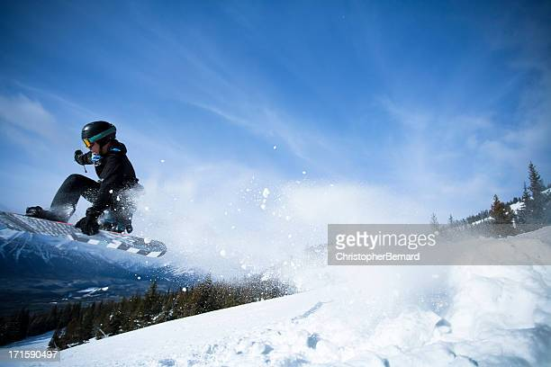 Man snowboarding in the mountain
