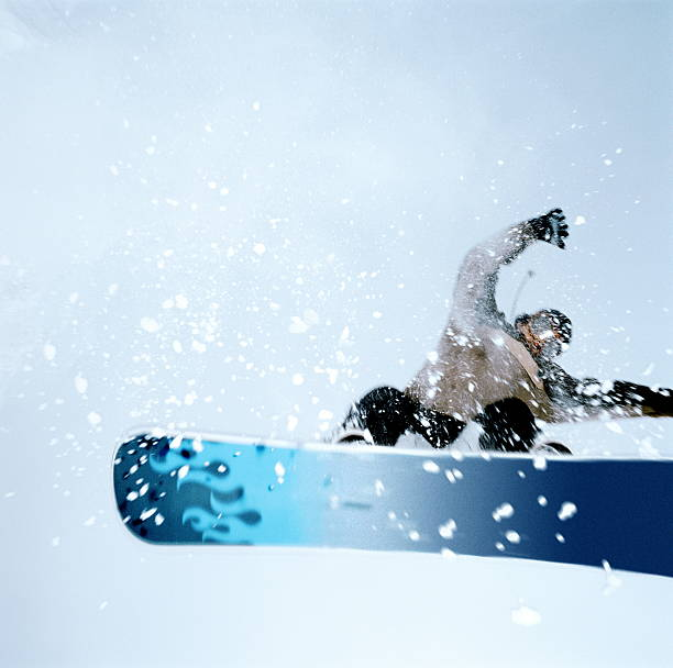 Man snowboarding, mid-jump. low angle view