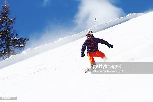 Man Snowboarding On Mountain Slope