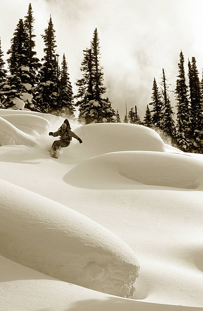 Man snowboarding (B&W sepia tone)