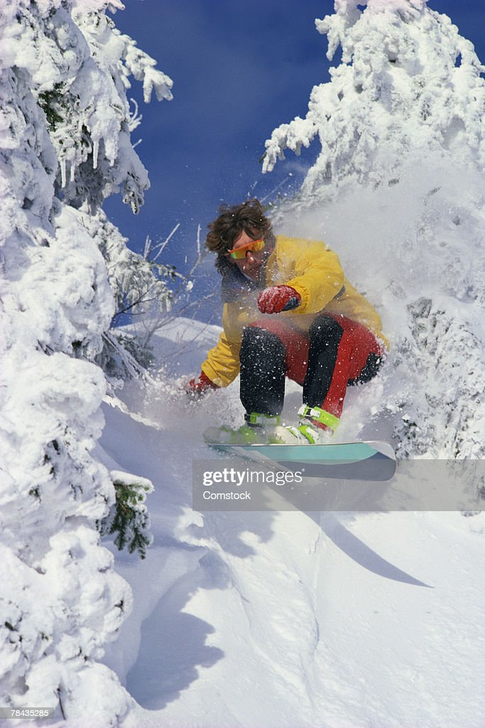 Man snowboarding : Stockfoto