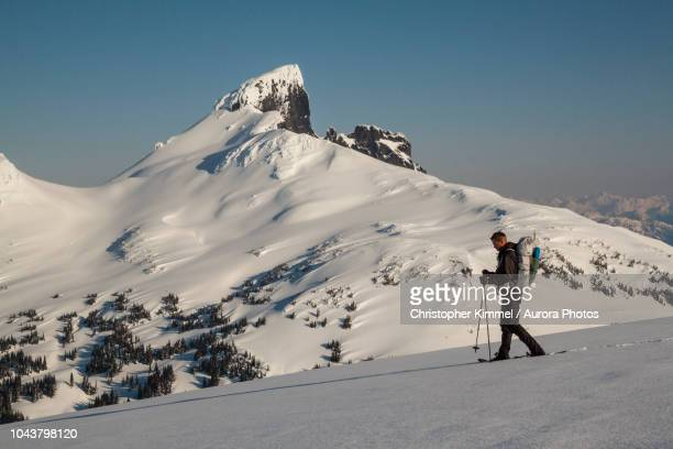 man snowshoeing in garibaldi provincial park near black tusk mountain - garibaldi park stock pictures, royalty-free photos & images