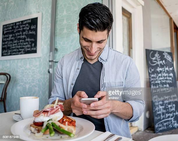 Man social networking at a restaurant