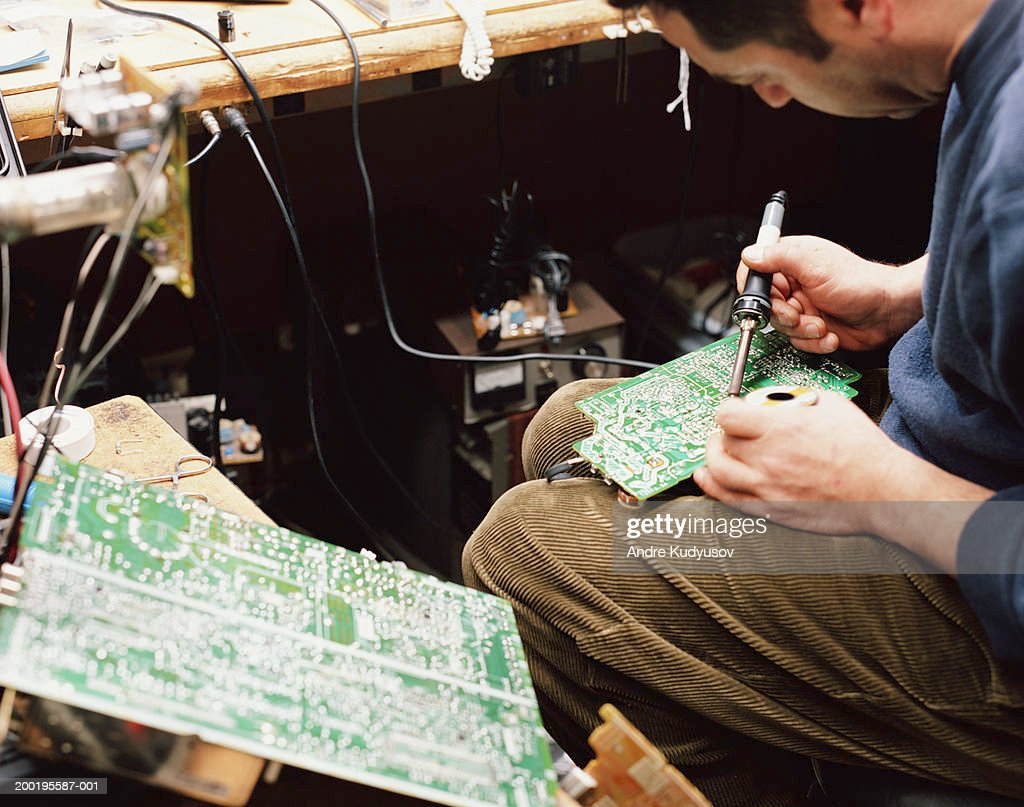 Man Soldering Circuit Board Side View Stock Photo Getty Images On