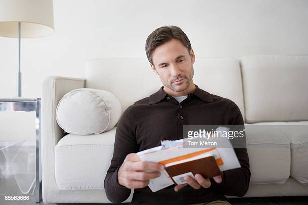 Man sorting bills at home