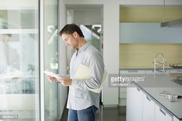 man sorting mail at home - mail stock pictures, royalty-free photos & images