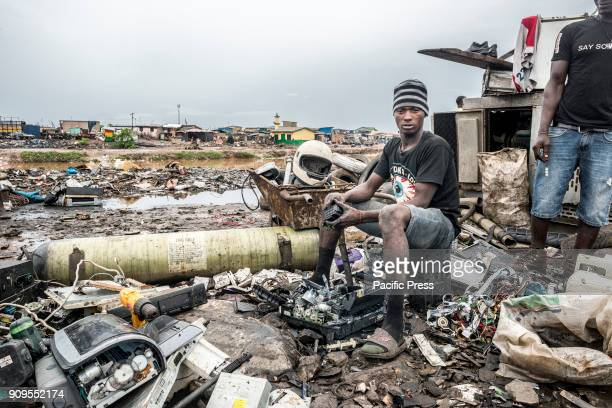 A man sorting the recyclable junk In the outskirts of Accra there is the biggest electronic waste disposal site also called by the locals with...