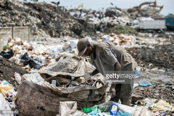 A man sorts out plastic bottles at the Dandora rubbish dump on March 14 2018 in Nairobi Kenya The Dandora landfield is located 8 Kilometer east of...