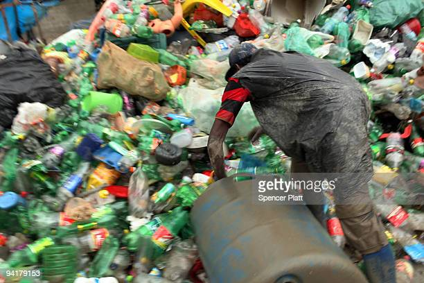 A man sorts plastics to be recycled at the Jardim Gramacho waste disposal site on December 9 2009 in Jardim Gramacho Brazil Referred to as the...