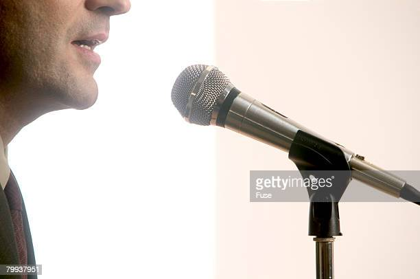 Man Speaking Into Microphone