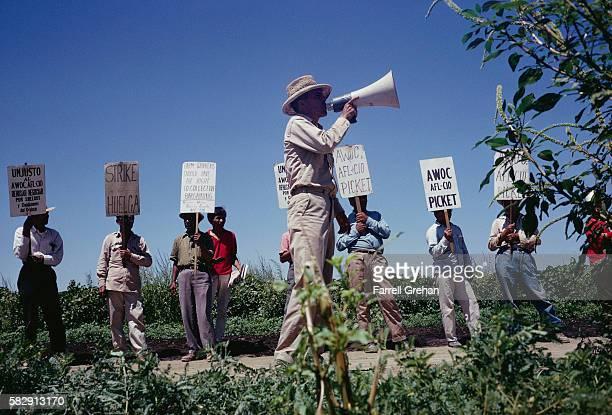 Man Speaking Through a Bullhorn at a Strike