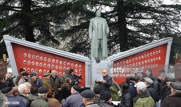 A man speaks at a rebuilt statue of Soviet dictator Joseph Stalin in the Georgian village of Alvani on December 21 2012 The statue went back up today...