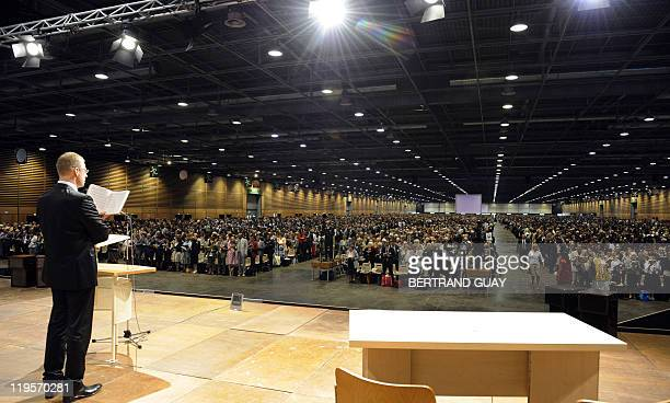 A man speaks during the annual Jehovah's Witnesses assembly gathering 30000 believers on July 22 2011 in Villepinte Paris suburb European rights...