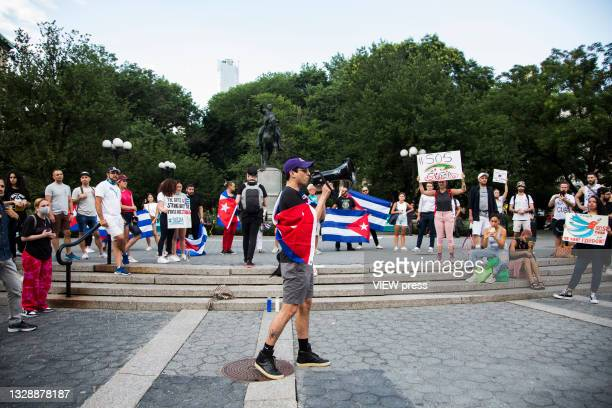 Man speaks into a megaphone in support of Cuban protesters in Union Square Park on July 14, 2021 in New York City. A small group of people gathered...