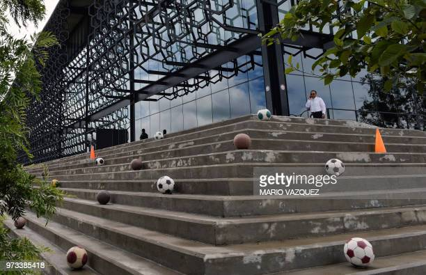 A man speaks on a mobile phone at the headquarters of the Mexican Football Federation in Toluca Mexico on June 13 2018 day in which FIFA announced...