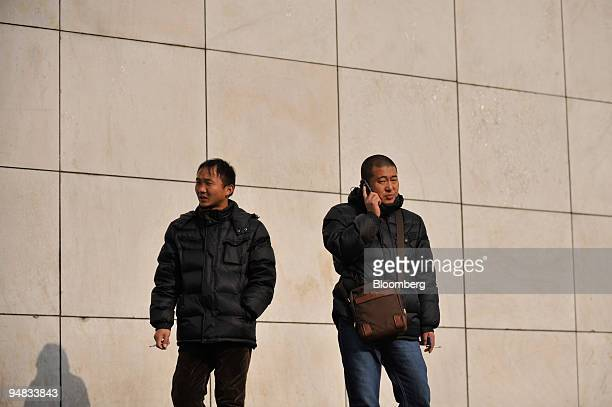 A man speaks on a mobile phone in Beijing China on Wednesday Jan 7 2009 China will issue licenses for highspeed mobilephone services later today...