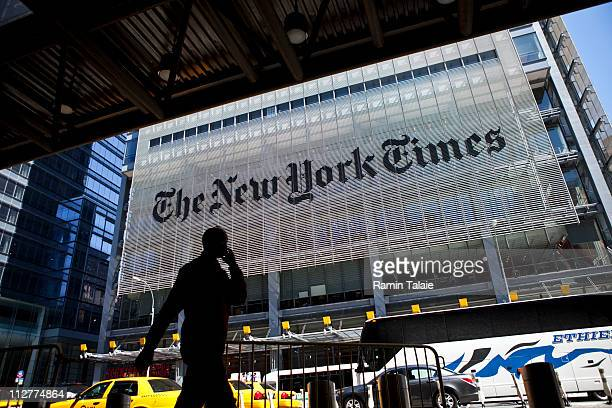 A man speaks on his mobile phone across from The New York Times headquarters building April 21 2011 in New York City The New York Times profits fell...