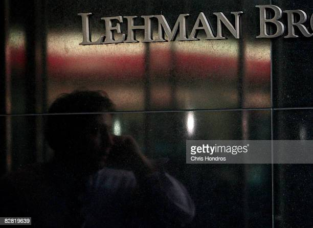 A man speaks on his phone as he stands outside the headquarters of the financial firm Lehman Brothers Holdings Inc September 15 2008 in New York City...