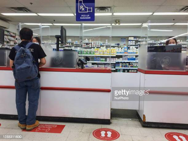 Man speaks to a pharmacist before receiving his second dose of the Pfizer-BioNTech COVID-19 vaccine in Vaughan, Ontario, Canada on June 06, 2021. To...