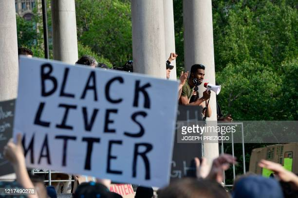 A man speaks to the people gathered during a Black Lives Matter rally and march in response to the death of George Floyd and other victims of Police...
