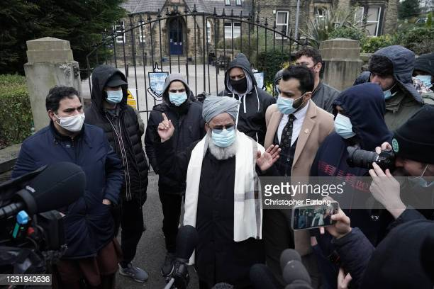Man speaks to the press as people gather outside the gates of Batley Grammar School after a teacher was suspended for showing an image of the Prophet...