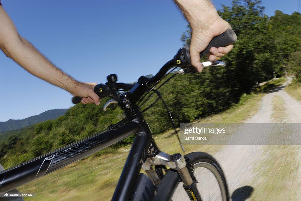 Man speeding on mountain bike (blurred motion) : Stock Photo