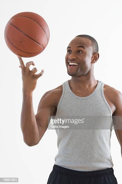 Man spinning basketball on finger