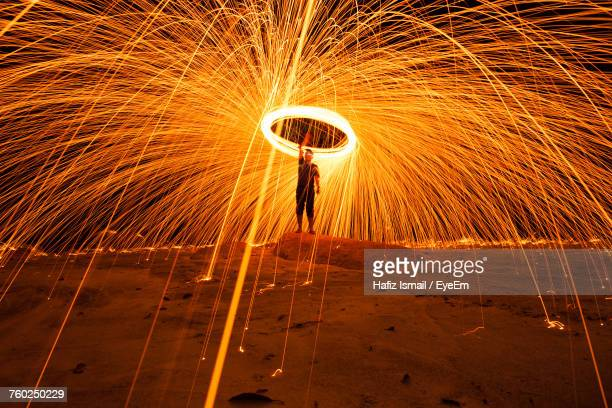 man spinning wire wool at night - spinning stock pictures, royalty-free photos & images