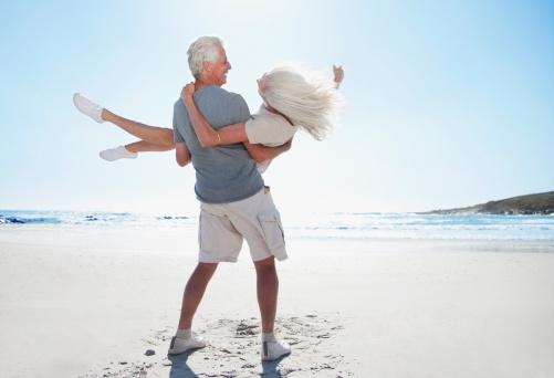 Man spinning woman on beach - gettyimageskorea