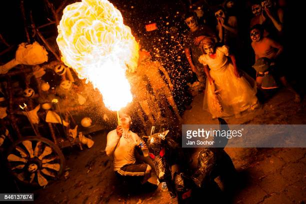 A man spits fire during the Day of the Dead festival on November 01 2016 in San Salvador El Salvador Day of the Dead known as La Calabiuza is a...