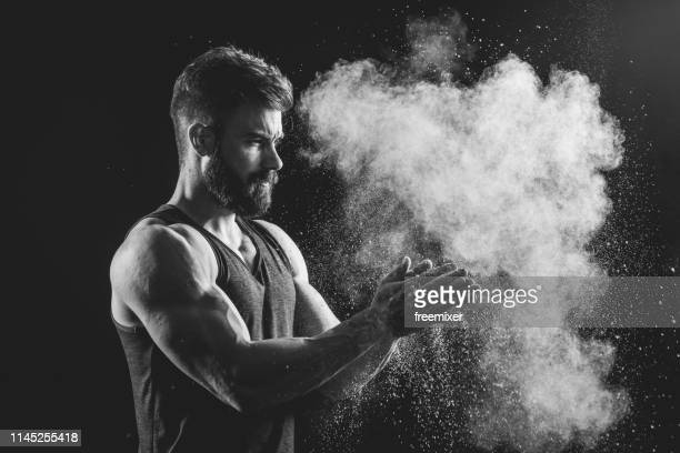 man splashing colorful powder - body building stock pictures, royalty-free photos & images