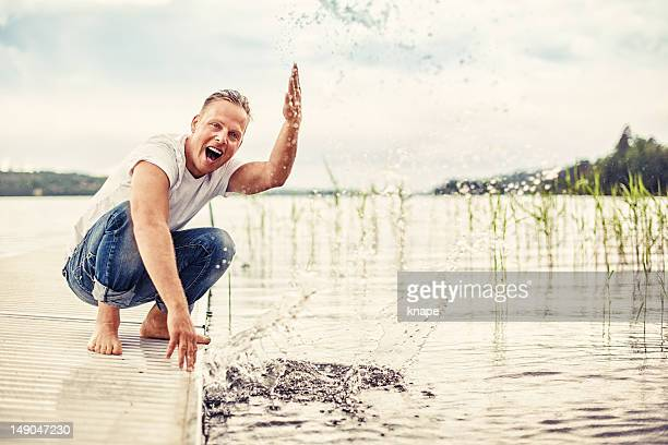 Man splashing water