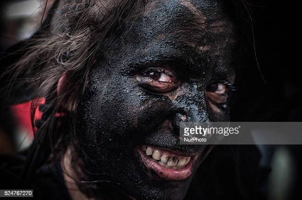 A man sporting horns on his head and grease on his face performs as a quotDiablo de Luzonquot during the carnaval in Luzon near Guadalajara on...