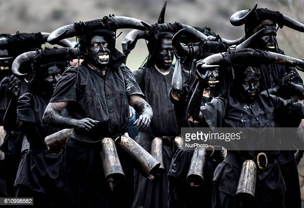 """Man sporting horns on his head and grease on his face performs as a """"Diablo de Luzon"""" during the carnaval in Luzon, near Guadalajara, on..."""