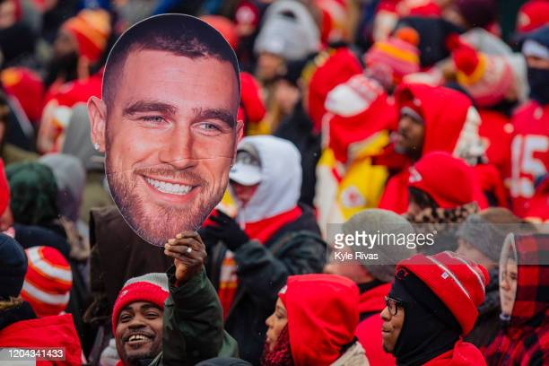 A man sports a Travis Kelce face cutout while waiting for the Kansas City Chiefs Victory Parade on February 5 2020 in Kansas City Missouri