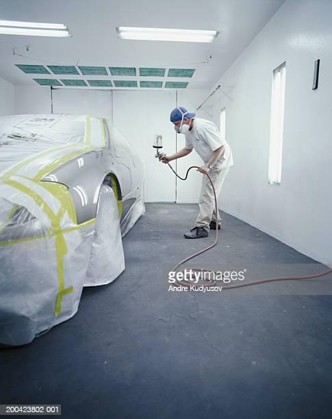 Man spray painting car
