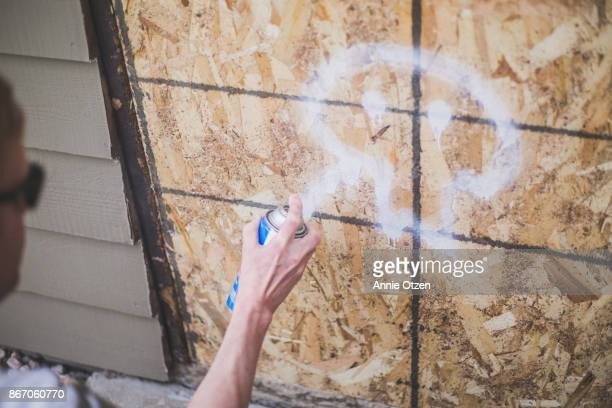 man spray painting - annie sprinkle stock pictures, royalty-free photos & images