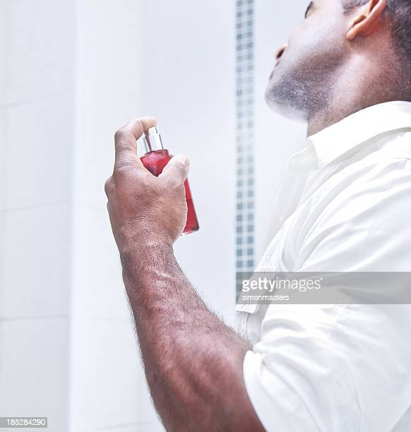 man spraying aftershave - cologne stock pictures, royalty-free photos & images