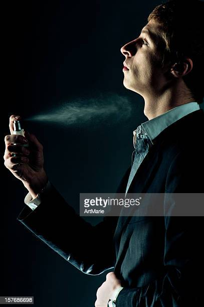 Man spraying perfume